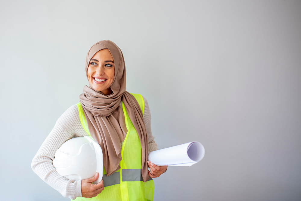 A highly-skilled female worker wearing a hijab