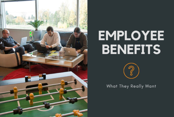 Colleagues sitting around a table and a table football, Employee Benefits: What they really want